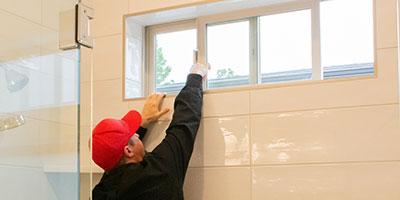 home inspector inspecting bathroom windows