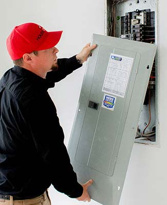 home inspector inspecting electrical panel